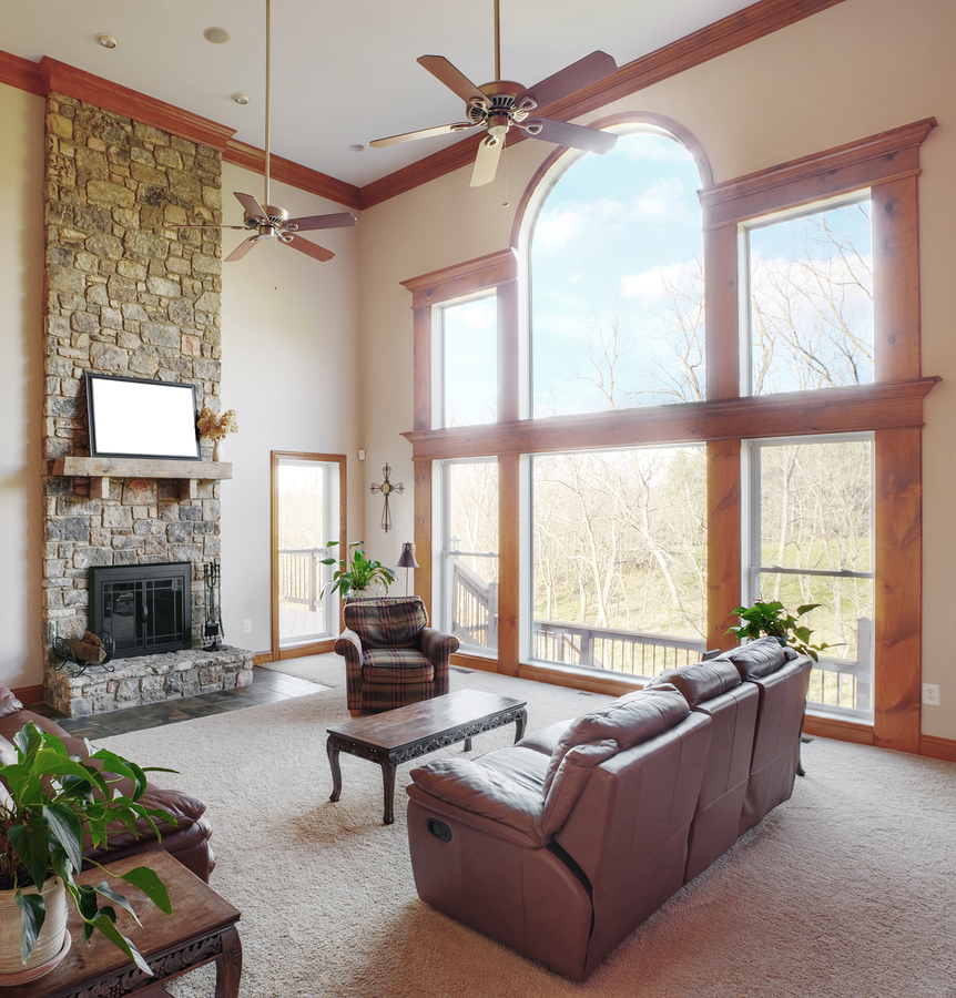 Traditional Living Room Interior With A High Ceiling And Large Windows Square Format
